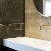 Brass accents are a feature of this bathroom.