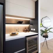 ​​​​​​​The kitchen in this versatile and contemporary GJ architecture, building, cabinetry, countertop, design, gj gardner homes, black cabinets, appliances, fisher & paykel