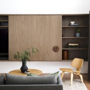 A sliding cabinetry door reveals various storage/decor options