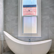 The tub makes a strong end-of-room statement in architecture, bathroom, bathtub, door, floor, flooring, interior design, plumbing fixture, property, room, tile, wall, window, gray
