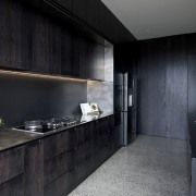 The dark stained oak cabinetry and Florim Matte architecture, building, cabinetry, ceiling, countertop, floor, flooring, furniture, house, interior design, kitchen, kitchen stove, material property, property, room, tile, under-cabinet lighting, black, gray