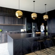 The combination of floor-to-ceiling cabinetry and camouflaged handles architecture, building, cabinetry, ceiling, countertop, design, floor, flooring, furniture, home, house, interior design, kitchen, lighting, material property, property, real estate, room, table, under-cabinet lighting, black, gray
