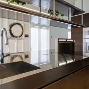 A pop-up Gaggenau extractor does away with the countertop, interior design, kitchen, gray, black