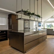 Clean, angular architectural lines and neutral colours reflect countertop, interior design, kitchen, real estate, gray, brown