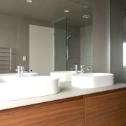 To prevent mould, crevices and grout lines were architecture, bathroom, bathroom accessory, bathroom cabinet, bathroom sink, bathtub, building, ceramic, floor, furniture, house, interior design, material property, plumbing fixture, property, room, sink, tap, tile, gray, white