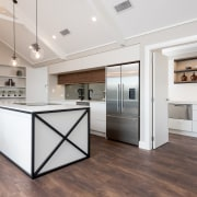 The contemporary kitchen island includes a more rustic