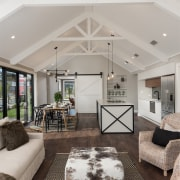 This home's sprawling, open-plan kitchen-living-dining area features a