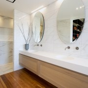 The custom shower stall has a central glass