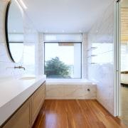 Rich matai flooring and the American oak vanity