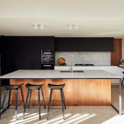 The new contemporary kitchen with the servery window
