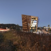 The building's striking 24° tilted roof gently slopes
