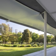 """I thought that the pavilion needed to address architecture, building, canopy, grass, real estate, shade, tree, gray"