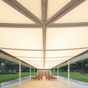 The MPavilion consists of a rectangular plan and architecture, building, canopy, ceiling, daylighting, grass, infrastructure, pavilion, roof, shade, walkway, yellow