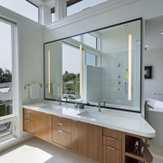 The house was designed to be a sustainable countertop, interior design, kitchen, sink, window, gray