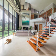 The living room combines a soaring ceiling with architecture, building, daylighting, floor, flooring, handrail, home, house, interior design, loft, property, real estate, residential area, room, stairs, wood, gray, white