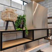 The kitchen celebrates natural as well as semi-industrial