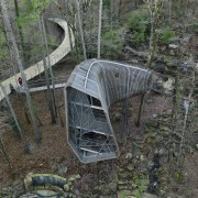 The treehouse easily bends among native pines and geological phenomenon, vehicle, gray, black