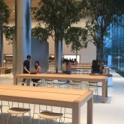 The store's clean, trapezoidal design lines and glass architecture, furniture, mixed use, table, brown