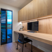 A generous timber-lined study includes natural and concealed