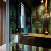 This powder room combines old-world architecture wallpaper with