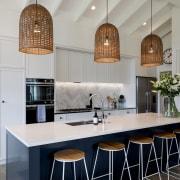 Three birdcage-like pendants are centred over the new