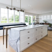 Wood floors provide a warm contrasting surface to