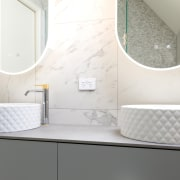 The double custom made vanity has textured Villeroy