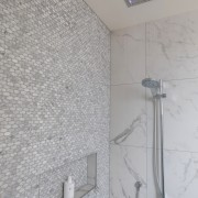 This walk in shower has a tile insert