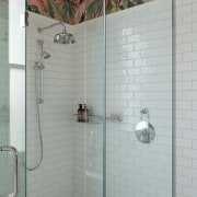 The glass shower stall adds to the room's
