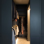 The dressing room includes underlit cabinetry that utilises