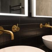 Regoli Nero Sticks finger tiles and brushed brass