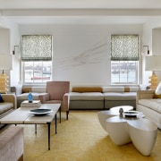The living room features a bright yellow silk