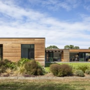 The north-east elevation of the cedar weatherboard-clad home.