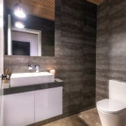 A concealed extraction system in the powder room architecture, bathroom, beige, bidet, brown, building, ceiling, ceramic, floor, flooring, furniture, home, house, interior design, lighting, material property, plumbing fixture, property, room, sink, tap, tile, wall, black