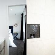 Herringbone pattern wall and shower tiles add a