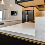 The centrally set island and rear benchtop are