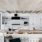 A pale interior palette ensures the water outlooks
