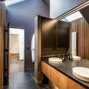Large roof skylights flood the bathroom, dressing room
