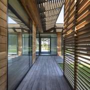 Cedar screens contrast the silvered timber walkways and