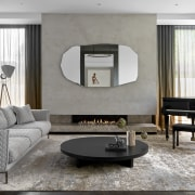 The piano room includes a quirky mirror from
