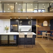 A timber bulkhead ceiling over the central kitchen