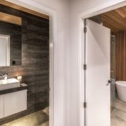 The toilet is in a separate room next architecture, bathroom, bathroom accessory, bathroom cabinet, beige, building, ceiling, door, floor, furniture, home, house, interior design, plumbing fixture, property, real estate, room, sink, suite, tap, tile, wall, white
