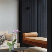 1970's home becomes a modern entertainer's dream - building, chair, coffee table, couch, door, floor, flooring, furniture, house, interior design, living room, room, table, wall, wallpaper, wood, black, gray