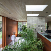 The entrance to tthe home is clad in architecture, building, ceiling, daylighting, floor, house, interior design, lobby, plant, real estate, room, gray