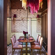 A 10-seat private dining room invites guest into chair, dining room, furniture, home, interior design, living room, room, table, wall, window, red