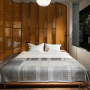 The oiled oak bed in the Serene zone architecture, bed, bed frame, bed sheet, bedding, bedroom, boutique hotel, building, ceiling, floor, furniture, hardwood, house, interior design, mattress, mattress pad, property, real estate, room, suite, wall, brown