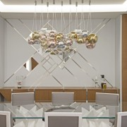 Complementing the dining table, is Ascension, a display architecture, ceiling, ceiling fixture, chandelier, design, dining room, furniture, interior design, light fixture, lighting, lighting accessory, material property, room, table, wall, white, gray