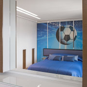 The boy's room, a football fan, was fitted architecture, bed, bed frame, bed sheet, bedding, bedroom, blue, building, ceiling, floor, furniture, house, interior design, mattress, property, room, suite, wall, gray
