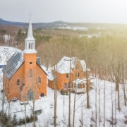 Neogothic architecture with contemporary character architecture, atmospheric phenomenon, building, chapel, church, freezing, geological phenomenon, place of worship, rural area, snow, steeple, winter, white