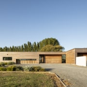 The garage extends beyond the home's essential L